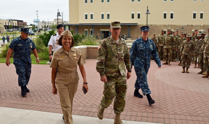 Defense Health Agency's Director, Navy Vice Adm. Raquel Bono (center, foreground) reminds everyone October is Women's Health Month and a great time to remember that women owe it to themselves and their loved ones to make their health a priority. (DoD file photo)