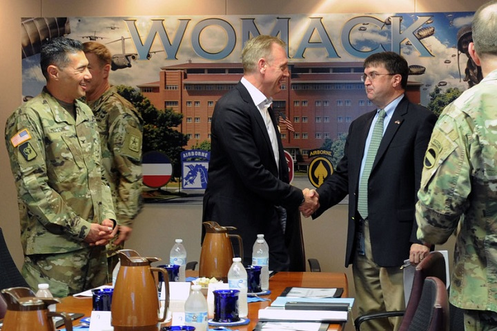 Deputy Defense Secretary Patrick M. Shanahan greets Veterans Affairs Secretary Robert Wilkie as Army Col. John Melton, the commander of Womack Army Medical Center, looks on, at the start of a meeting at Womack Army Medical Center, Fort Bragg, North Carolina, July 26, 2018. Shanahan convened the meeting to discuss medical readiness, as well as how the Defense Health Agency and military services are collaborating on the integration of the Military Health System. (DoD photo by Lisa Ferdinando)