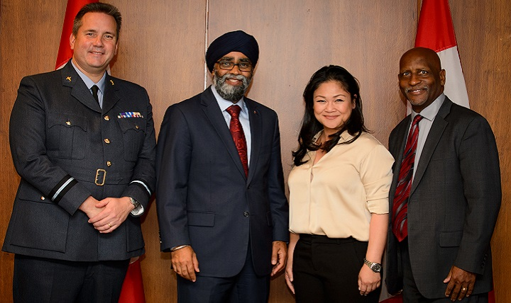 Air Commodore Rich Withnall, United Kingdom WC21 co-chair (left), Harjit Sajjan, Canada's minister of national defence (center left), Dr. Dorothy Narvaez-Woods, special assistant to the assistant secretary of defense for health affairs (center right), and Mr. Bret Stevens, U.S. WC21 co-chair (right) pose for a photo following Minister Sajjan's  keynote address. Senior representatives from 14 attending nations discussed their nations' strategic priorities for warrior care. (Canadian Armed Forces photo by Corporal Lisa Fenton)