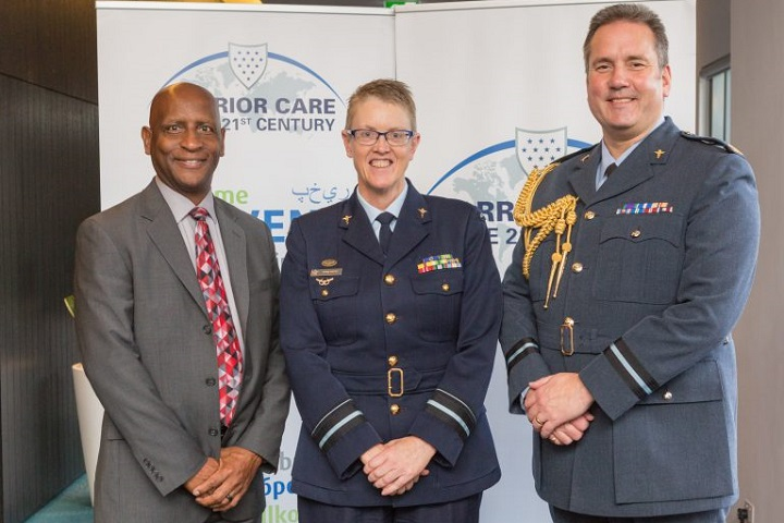 Mr. Bret Stevens, director of disability evaluation systems, DoD Health Services Policy and Oversight and United States WC21 co-chair (left), Air Vice-Marshal Tracy Smart, surgeon general, Australian Defence Force (center), and Air Commodore Rich Withnall, United Kingdom WC21 co-chair (right) pose for a photo. Senior representatives from 11 nations discussed warrior care challenges, lessons learned, and innovations during this year's event. (Photo courtesy from the Australian Defence Force)