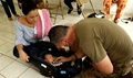 Staff Sgt. Matthew Crabtree, a medic with the 285th Medical Company (Area Support) and a registered nurse, performs a medical assessment on an infant less than one month old Oct. 27, 2017, in Jayuya, Puerto Rico. Military medical personnel were critical to disaster response related to hurricanes Harvey, Irma, and Maria. (Ohio National Guard photo by Sgt. Joanna Bradshaw)