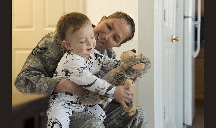 Air Force Staff Sgt. Charity Lee Vest, 87th Aerospace Medicine Squadron operational medicine technician, holds baby Arlo at his home on Joint Base McGuire-Dix-Lakehurst, New Jersey. Vest received a knock on the door from a neighbor who exclaimed their 14 month-old son was unresponsive and needed medical attention. Vest used her CPR training to resuscitate the infant. (U.S. Air Force photo by Airman 1st Class Jessica Blair)
