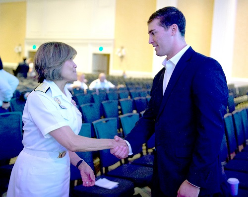Navy Vice Adm. Raquel C. Bono greets retired Army Sgt. Oliver Campbell after his moving presentation at 2019 MHSRS about how he survived near-fatal gunshot wounds during a 2016 Afghanistan mission. (MHS photo)