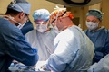 Army Maj. Daniel Nelson, surgical oncologist and director of the Commission on Cancer at William Beaumont Army Medical Center, instructs medical residents during a bilateral mastectomy at WBAMC. Nelson, the only board-certified surgical oncologist in El Paso, is one of many physicians with advanced medical training, along with WBAMC's Commission on Cancer, preparing medical residents for unconventional cases they may experience throughout their careers. (U.S. Army photo By Marcy Sanchez)