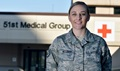 U.S. Air Force Staff Sgt. Cassidy McCurdy, 51st Medical Group independent medical duty technician, poses for a photo at Osan Air Base, South Korea. McCurdy has more than five years of experience in the medical field including two years as an IDMT. On a flight from San Francisco to Seattle she responded to a passenger, who went into cardiac arrest, by providing cardiopulmonary resuscitation and stabilizing the passenger. Once the aircraft landed, emergency responders from the ground transported the patient to the emergency room. (U.S. Air Force photo by Staff Sgt. Franklin R. Ramos)