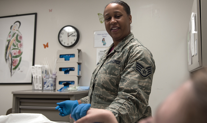 Air Force Staff Sgt. Ashley Williams, the 633rd Surgical Squadron women's health NCO, assists a patient during a routine Pap test at Langley Air Force Base, Virginia. (U.S. Air Force photo by Airman 1st Class Kaylee Dubois)