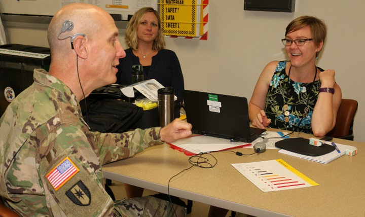 Dr. Elizabeth Searing (right) makes initial adjustments via a computer to Lt. Col. James Morrison's cochlear implant. Dr. April Luxner, an audiologist with Cochlear Corporation, was on hand to witness Morrison's reactions to hearing with his right ear after 12 years of deafness. (U.S. Army photo by Jeff Troth)