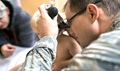 Air Force Capt. Michael Guindon, 374th Medical Group pediatrician, examines a young patient's ear at Yokota Air Base, Japan. Odds are, your child will suffer an ear infection by age three. (U.S. Air Force photo by Senior Airman Delano Scott)