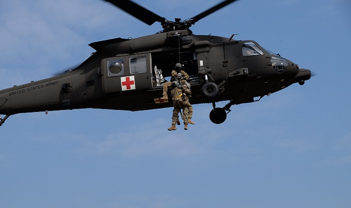 Soldiers from the 7th Mission Support Command, Medical Support Unit-Europe conduct medical evacuation training with Staff Sgt. Jessie Turner, flight medic with the 1st Armored Division's Combat Aviation Brigade. (U.S. Army photo by Sgt. 1st Class Matthew Chlosta)