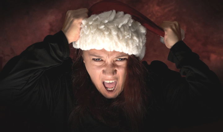 Airman Adrianna Barelas, 4th Space Operations Squadron system administrator, displays her Grinch side for the holiday season at Schriever Air Force Base, Colorado, Dec. 1, 2017. Many things can cause stress during the holidays, including travel, financial strain from gift buying, and the expectations of friends and family. (U.S. Air Force photo by Airman 1st Class William Tracy)