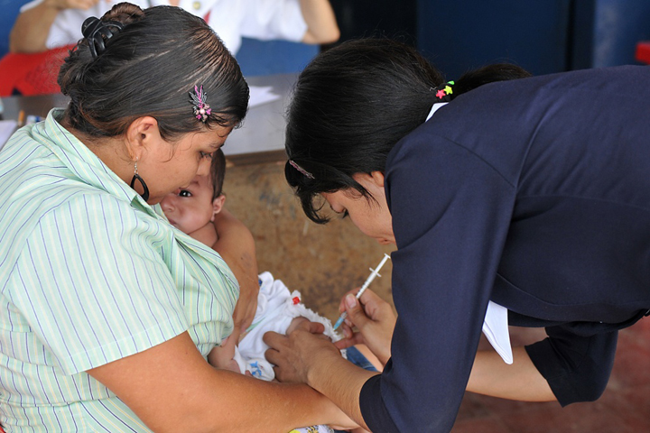 A Salvadoran nurse vaccinates a baby during a Task Force Northstar mission in El Salvador to provide medical care and other humanitarian and civic assistance. The mission involved U.S. military personnel working alongside their Brazilian, Canadian, Chilean, and Salvadoran counterparts. (U.S. Army Photo by Sgt. Kim Browne)
