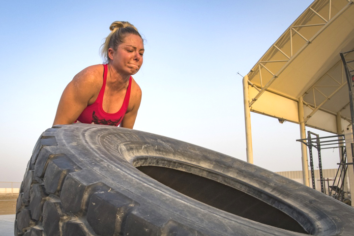 Master Sgt. Kimberly Kaminski, 380th Expeditionary Security Forces Squadron, flips a 445-pound tire during a workout at Al Dhafra Air Base, United Arab Emirates. Resistance training is just one of many steps to take to fight osteoporosis. (U.S. Air Force photo by Staff Sgt. Ross A. Whitley)