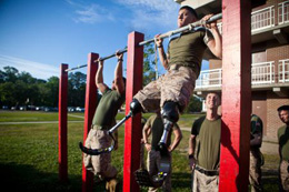 Lance Cpl. Adrian Simone, an infantryman with 1st Battalion, 6th Marine Regiment, from Montville, N.J., does pull-ups at Camp Lejeune, N.C., May, 08, 2012. Simone lost both of his legs to an improvised explosive device in August, 2011 in Helmand province, Afghanistan. DoD photo by Cpl. Jeff Drew