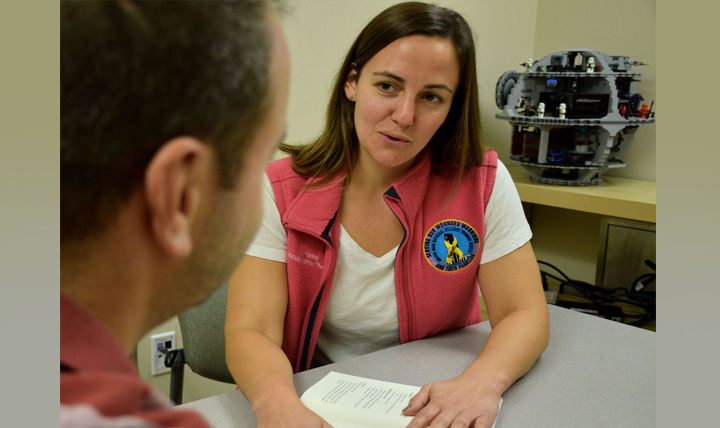 Occupational therapist Kathryn Ellis meets with a patient at Walter Reed National Military Medical Center in Bethesda, Maryland. (Courtesy photo)