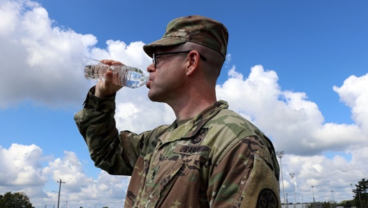 Staff Sgt. Shaun Martin, a combat medic assigned to Blanchfield Army Community Hospital's LaPointe Army Medical Home on Fort Campbell, drinks from a 16-ounce bottle of water to maintain his hydration for optimal performance. On average, the Army recommends men should consume about 100 ounces of fluid (3 liters) each day, and women should aim for about 70 ounces (2 liters) for baseline hydration. In hot and humid environments and during physical activity, more is needed to maintain hydration — about one ounce per pound of body weight. To reach your goal, drink regularly and frequently, even if you are not thirsty to avoid dehydration. Water is usually the best choice over coffee, soda, energy drinks and alcohol because those beverages can pull water from the body and promote dehydration. (U.S. Army photo by Maria Yager)