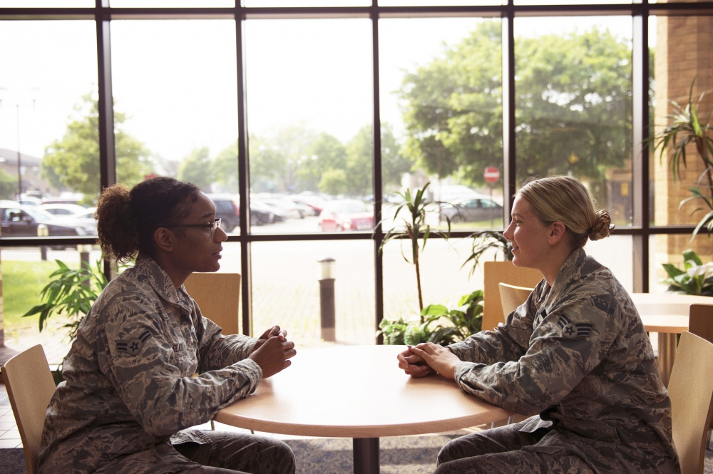 Mental health technicians assigned to the 48th Medical Group Mental Health Flight converse in the hospital reception area at Royal Air Force Lakenheath, England. The Mental Health Flight is one of many resources available to assist with depression and other mental health concerns. (U.S. Air Force photo/Airman 1st Class Shanice Williams-Jones)