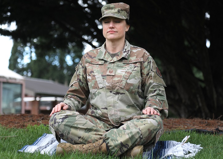 U.S. Air Force Master Sgt. Kathleen A. Myhre, 446th Airman and Family Readiness Center noncommissioned officer in charge, meditates outside the 446th Airlift Wing Headquarters building on Joint Base Lewis-McChord, Washington, Feb. 12, 2020. Myhre traveled to India in 2016 to study to become an internationally-certified yoga instructor. She now shares her holistic training with Reserve Citizen Airmen of the 446th AW. (U.S. Air Force photo by Staff Sgt. Mary A. Andom)
