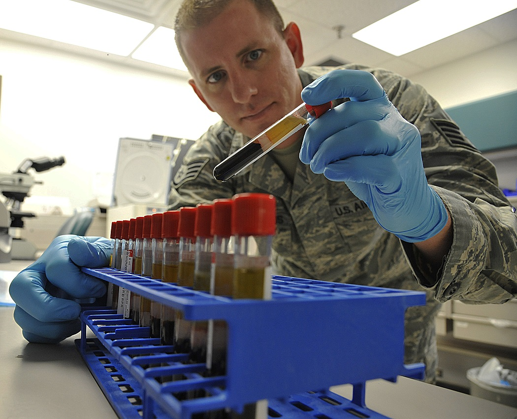 Photo of U.S. Air Force Staff Sgt. Jon Rigenoldus, 509th Medical Support Squadron medical lab technician, examines samples at Whiteman Air Force Base, Mo., March 18, 2015.