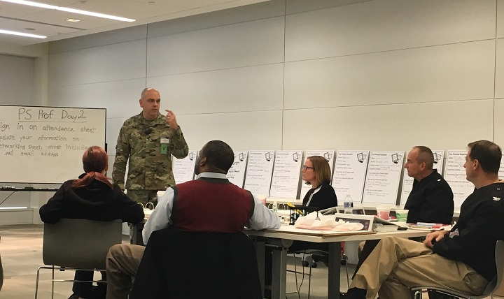 Col. Edward Yackel, senior staff officer in the U.S. Army Medical Command Patient Safety, Clinical Assurance Performance Directorate, engages with participants during the Patient Safety Professional course.
