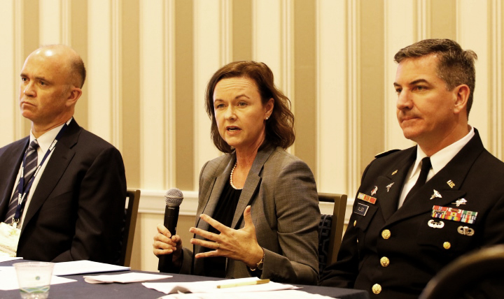 (Left to right) Dr. Paul Cordts, the Military Health System's functional champion in the development of MHS GENESIS, the military's new electronic health record keeping system, Stacy Cummings, program executive officer for the Defense Healthcare Management Systems, and Army Col. Richard Wilson, a division chief in the Health Information Technology directorate at the Defense Health Agency, talk about the development and deployment of MHS GENESIS at AMSUS 2016 on Nov. 29, 2016.