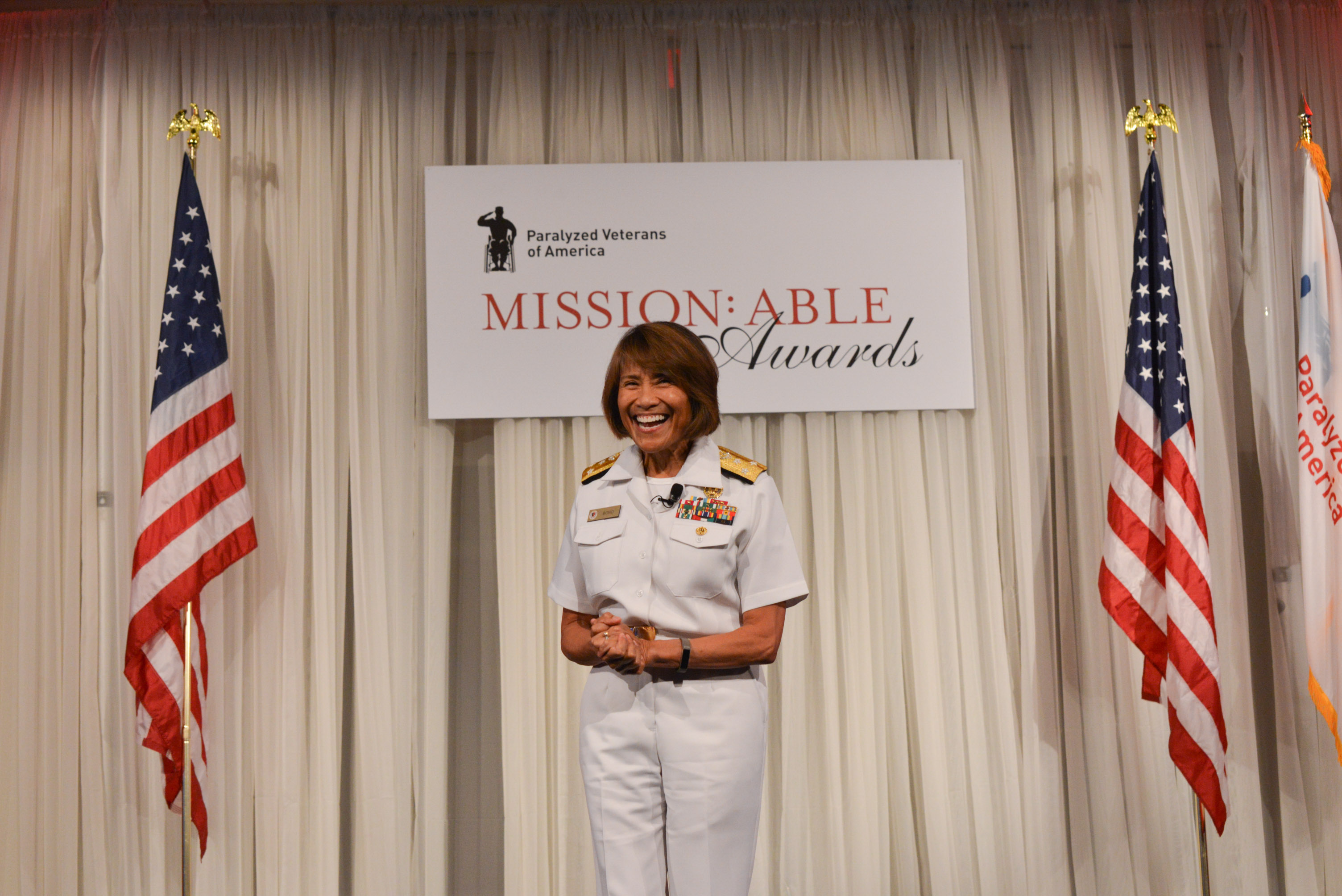 Defense Health Agency director Navy Vice Adm. Raquel Bono delivers keynote address to attendees of the Paralyzed Veterans of America's 'Mission:ABLE' awards ceremony in downtown Washington, DC.