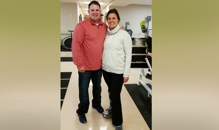 Retired Army Capt. Ferris Butler (left) and Jessica Kensky (right) on the day Kensky was cleared to stand after her initial surgery at Walter Reed National Military Medical Center in Bethesda, Maryland.