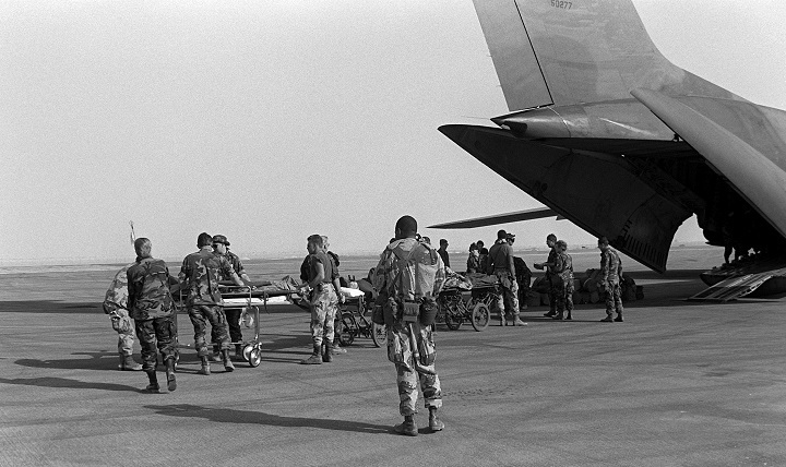 Medical personnel use litters to transport wounded to an Air Force C-141B Starlifter aircraft.  The patients were being medically evacuated from Al-Jubayl Air Base, Saudi Arabia to Germany during Operation Desert Storm.
