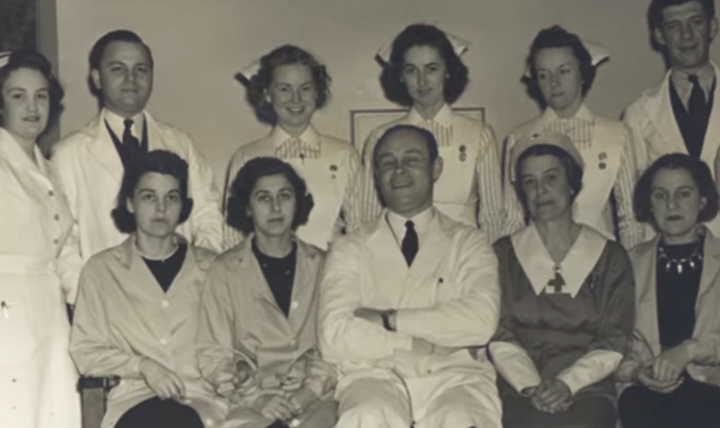 """Dr. Charles Drew (bottom row, center), an African American researcher, revolutionized the way the medical community stored blood products during World War II. Often referred to as the """"Father of Blood Banks,"""" Drew developed ways to process and store blood plasma in what we now call blood banks. (U.S. National Library of Medicine photo)"""