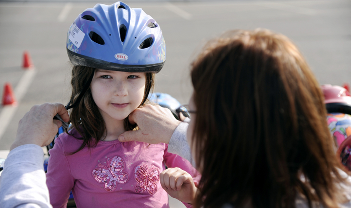 Educating your children about head injuries and making sure they use safety equipment properly can help reduce concussions and other forms of brain injuries. (U.S. Air Force photo by Staff Sgt. Jim Araos)