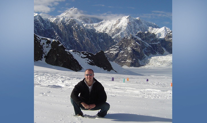 "James Coker focuses on protecting service member health every day as deputy chief of the Public Health Division at the Defense Health Agency. Here he is exploring a Mount Denali glacier ""off the clock"" while stationed in Alaska as a public health flight commander at Elmendorf Air Force Base. (Courtesy photo)"