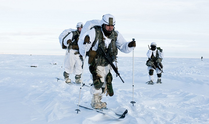 Paratroopers with U.S. Army Alaska's 4th Infantry Brigade Combat Team (Airborne), 25th Infantry Division ski across the drop zone during Exercise Spartan Pegasus in Deadhorse, Alaska.