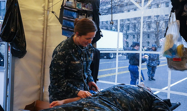 Navy Lt. j.g. Kimberly Kozlowski, assigned to the Walter Reed National Military Medical Center in Bethesda, Maryland, performs a blood pressure demonstration after the Inauguration of Donald J. Trump as the 45th President of the United States in Washington, D.C. More than 5,000 military members from across all branches of the armed forces of the United States, including Reserve and National Guard components, provided ceremonial support and Defense Support of Civil Authorities during the inaugural period. (DoD photo by Army Pvt. Genesis Gomez)