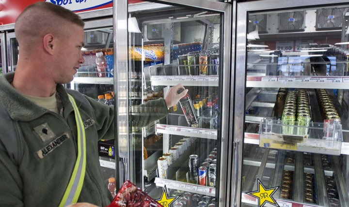 Army Spc. Kevin Alexander of 138th Quartermaster Company grabs an energy drink at the Post Exchange. Most energy drinks contain anywhere from 70 to 200 milligrams of caffeine. The daily recommended intake of caffeine is no more than 300 milligrams. (U.S. Army photo by Sgt. David Bruce)