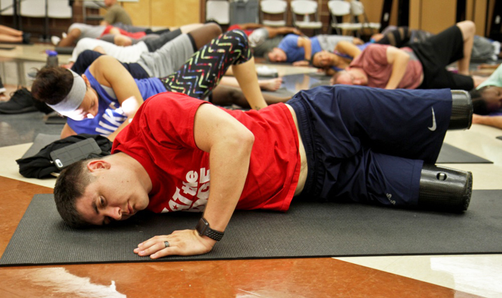 Marine Corps Sgt. Ivan Sears participates in a yoga class at Joint Base San Antonio. Topics like yoga and other therapeutic recreation programs for wounded warriors were covered during the Federal Advanced Amputation Skills Training or FAAST Symposium in Bethesda, Maryland. (U.S. Army photo by Staff Sgt. Tomora Nance)