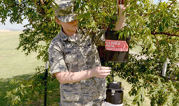 GEIS laboratory partners conduct surveillance of vector-borne diseases that are transmitted to humans, animals, and plants through arthropods such as mosquitoes. A U.S. Air Force Senior Airman sets up a dry ice trap to catch mosquitoes to test for viruses.