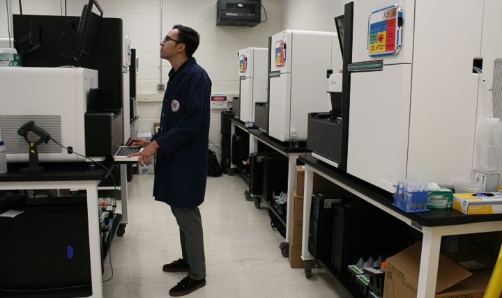 Nathan Watt, a research associate at the Uniformed Services University of the Health Sciences, closely monitors data on a next-generation sequencer in The American Genome Center at the university. This sequencing helps pinpoint genetic mutations that could serve as biomarkers, which can better predict disease risks and outcomes. TAGC is one of four academic genome centers in the U.S. and the only genome center in the federal system.  (DoD photo by Sarah Marshall)