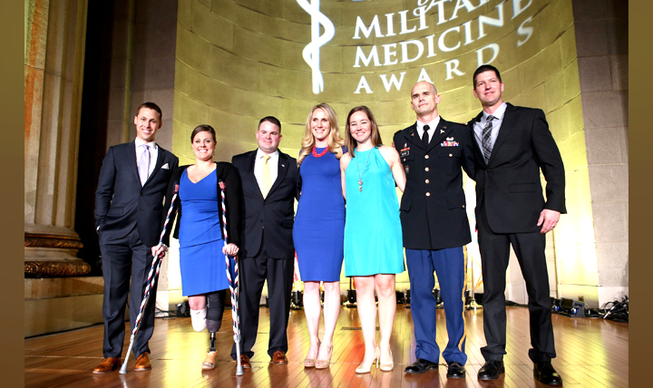 At the Heroes of Military Medicine ceremony Thursday, May 5, 2016, in Washington, D.C., honorees Patrick Downes, Jessica Kensky and Capt. Ferris Butler share the stage with Annemarie Orr, Kelly McGaughey, Lt. Col. Kyle Potter and Art Molnar.