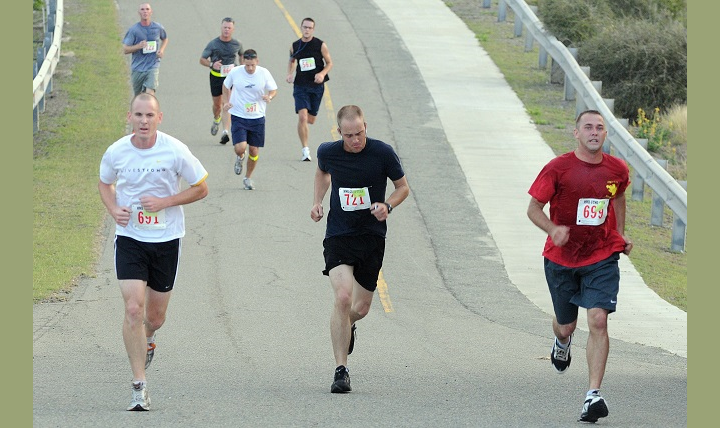 Service members of Joint Task Force Guantanamo and Naval Station Guantanamo Bay run up John Paul Jones Hill. Running hills is one of the best ways to get in shape, as long as you run them correctly. Your form is important for running uphill, just like it is for running on flat ground. (U.S. Navy photo by Mass Communication Specialist 3rd Class Kellie Bliss)