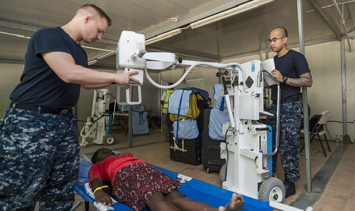 Navy Hospital Corpsman 3rd Class Connor Potts (left), assigned to Naval Medical Center Portsmouth, Va., and Navy Hospital Corpsman 3rd Class Michael Siem (right), assigned to the Admiral Joel T. Boone Branch Health Clinic Virginia Beach, Va., take an X-ray of a patient at a medical site established at Killick Coast Guard Station in support of Continuing Promise 2015. (U.S. Navy photo by Mass Communication Specialist 3rd Class Kameren Guy Hodnett)
