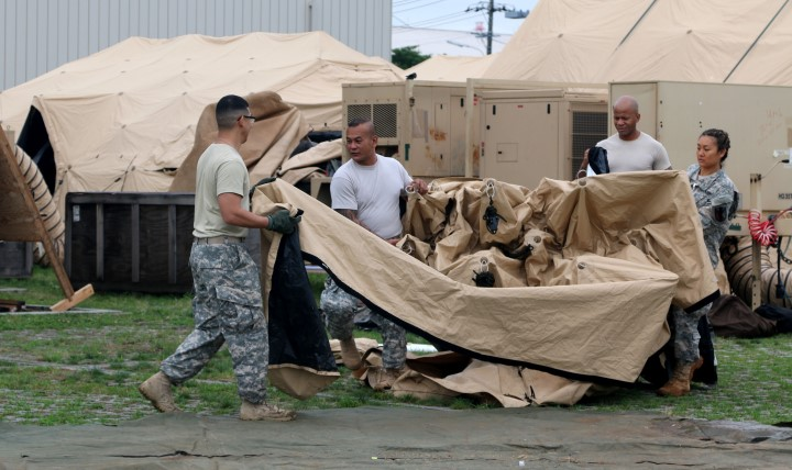 Soldiers break down a portion of a Deployable Rapid Assembly Shelter during an exercise in Japan. A new tool is helping medical personnel make sure soldiers are ready to deploy long before they arrive at any processing lines. (Photo by Army Staff Sgt. Chanelcherie DeMello)