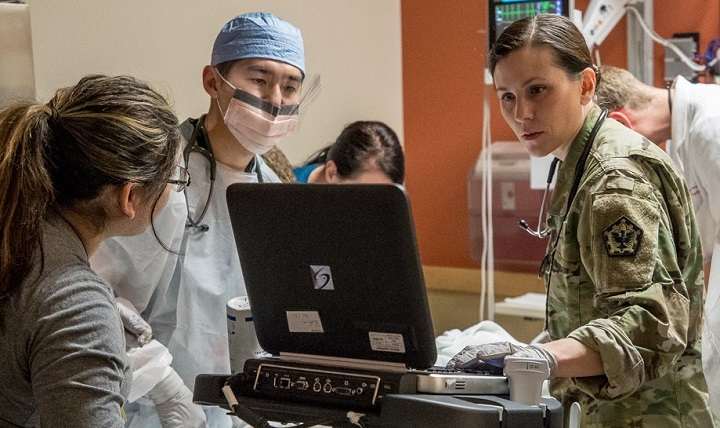 Staff at Madigan Army Medical Center in Tacoma, Washington, treat patients. The 2017 results of the Defense Department's Joint Outpatient Experience Survey show an increase in patient satisfaction with military medical facilities and pharmacy care. (U.S. Army photo)