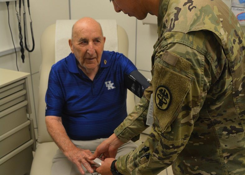 A Soldier provides medical care. (U.S. Army photo)