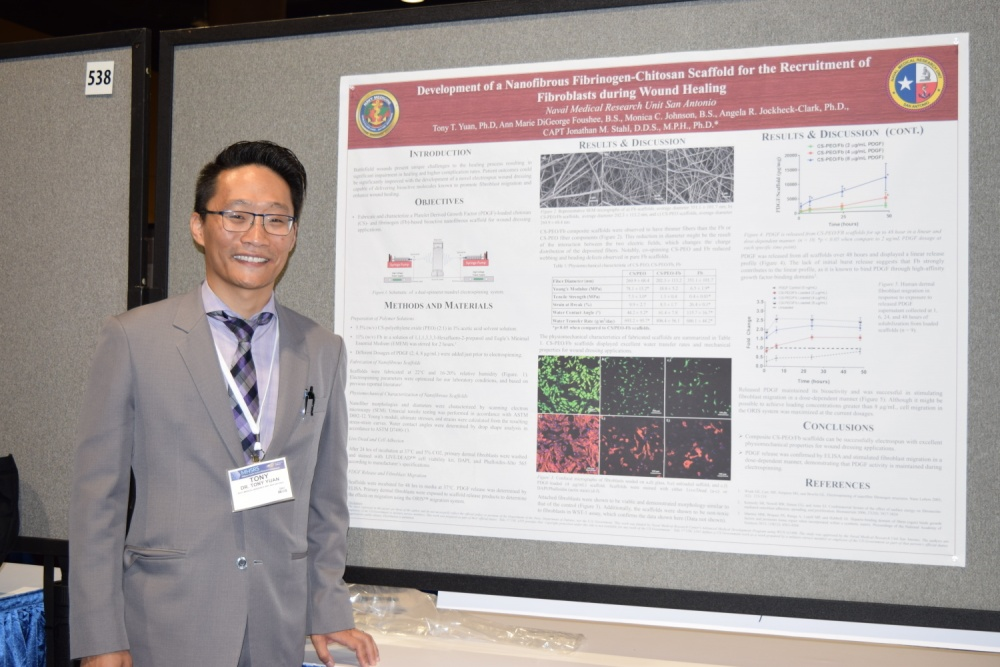 Photo By Katherine Berland | Dr. Tony Yuan from Naval Medical Research Unit - San Antonio presented a poster on the development of a nanofibrous fibrinogen-chitosan scaffold for the recruitment of fibroblasts during wound healing at the Military Health Systems Research Symposium, Kissimmee, Florida, August 29. (U.S. Navy Photo/Released/Katie Berland)