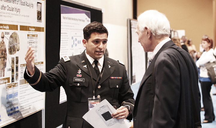 Army Capt. Nikhil Godbole, Madigan Army Medical Center, Joint Base Lewis-McChord, Washington, talks with a fellow attendee of last year's Military Health System Research Symposium. This year's meeting, the only large, broad-based research conference focusing on the unique medical needs of the military, takes place Aug. 27-30 in Kissimmee, Florida.