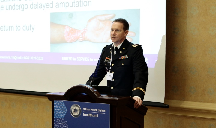 Army Lt. Col. David Saunders, the extremity repair product manager for the U.S. Army Medical Material Development Activity, Fort Detrick, Maryland, talks about extremity regeneration at the Military Health System Research Symposium in Kissimmee, Florida, Aug. 28, 2017.