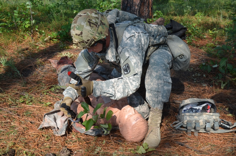 A soldier applies a tourniquet to a simulated casualty during a training exercise. (Courtesy photo)