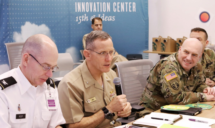 Navy Rear Adm. David Lane shared his thoughts and questions with innovators after each presentation during the National Capital Region's one-day innovation summit Feb. 27.