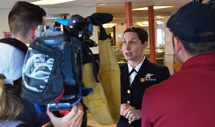 Navy Lt. Cmdr. Erika Schilling, a nurse midwife at Naval Hospital Bremerton, Washington, is interviewed by radio and television reporters in Seattle, Jan. 18, 2018. Shilling was recognized by Washington State Ferries with the Life Ring Award certificate for her life saving efforts on Dec. 2, 2017, when she saved a male passenger's life by administering emergency cardiopulmonary resuscitation for 14 minutes on the Kingston-Edmunds ferry. (U.S. Navy photo by Douglas Stutz)