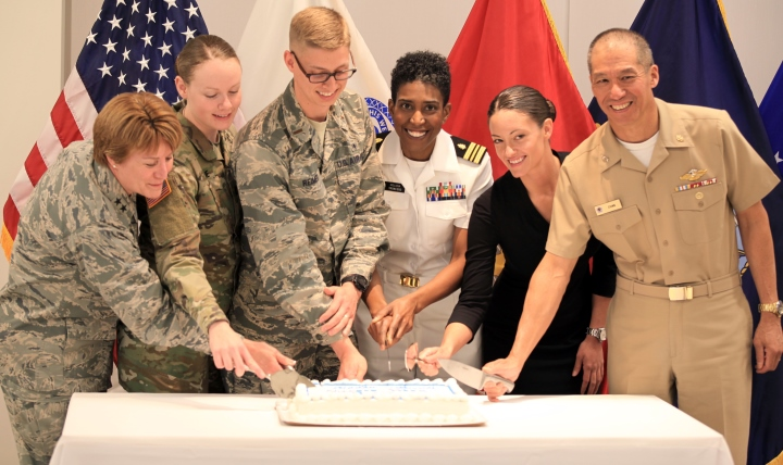 (l-r) Maj. Gen. Dorothy Hogg, Air Force deputy surgeon general and chief of the Air Force Nurse Corps; Army 1st Lt. Kelsey Lane, Ft. Belvoir Community Hospital; Air Force 2nd Lt. Jeffery Reimer, Ft. Belvoir Community Hospital; Navy Lt. Cmdr. Melissa Troncosco, student nurse and Ph.D. candidate at the Uniformed Services University of the Health Sciences; Army Sgt. Elizabeth Marks, winner a gold medal in swimming at the 2016 Paralympic Games in Rio; and Navy Rear Adm. Colin Chinn, acting deputy director for the Defense Health Agency, took part in a cake cutting during a ceremony honoring military nurses during National Nurses Week at the Defense Health Headquarters in Falls Church, Virginia, May 9, 2017.