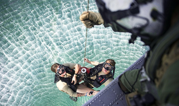 An MH-60S Seahawk helicopter hoists Navy Petty Officer 2nd Class Ben McCracken, left, and Petty Officer 3rd Class Sean Magee from the water during a Pacific Partnership 2016 search and rescue drill in Padang, Indonesia. (U.S. Navy photo by Petty Officer 3rd Class Trevor Kohlrus)